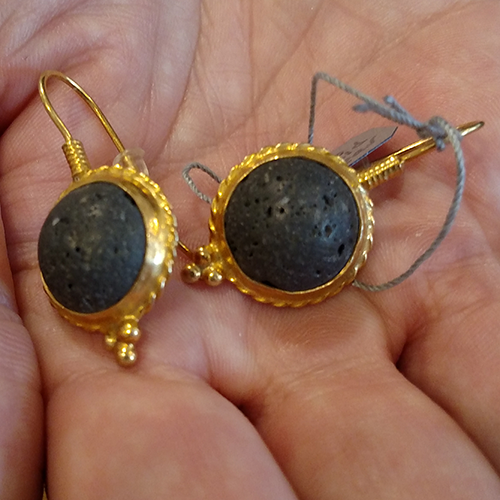 Black and gold earrings lava centers