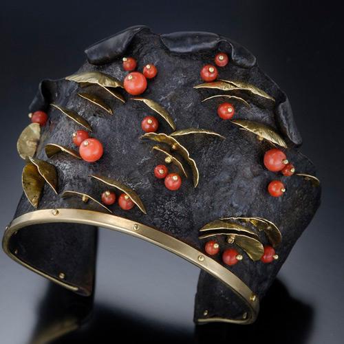 gold, steel and oxblood bracelet