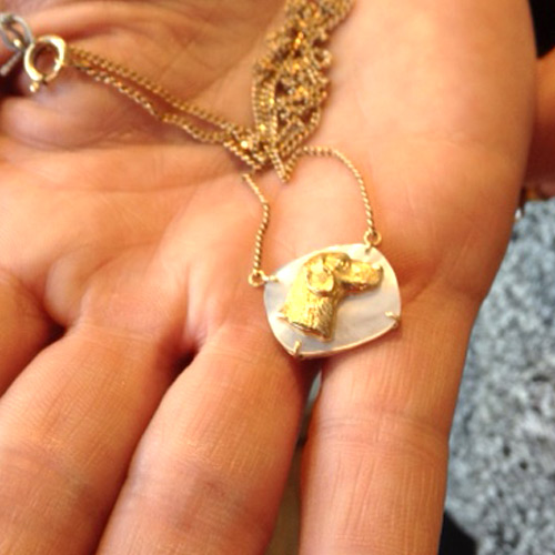 gold and mother of pearl dog pendant