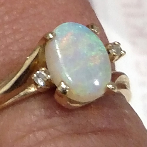 Gold, opal, diamond ring