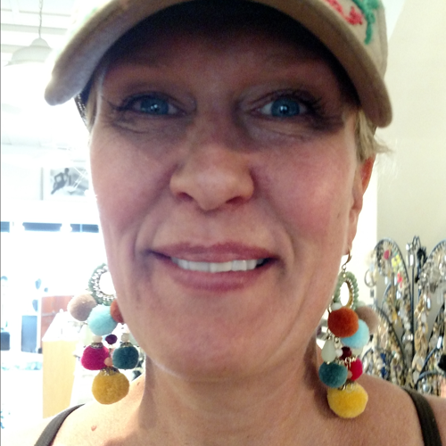 Pom pom and crystal earrings