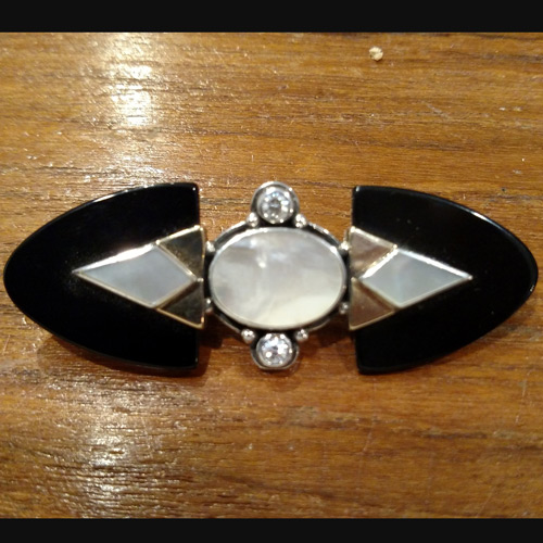 Art deco onyx, mother of pearl and topaz pin