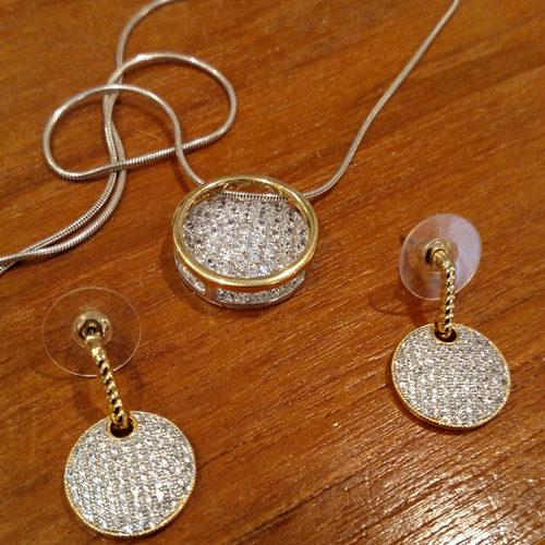 18K and cz earrings and pendant.