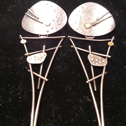 Studio sterling and 18k earrings.