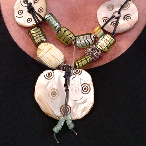 Tracy Keener glass and mother if pearl necklace.
