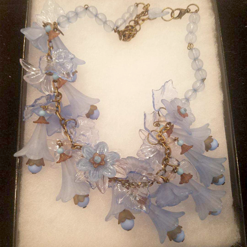 Vintage acrylic blue flower necklace.