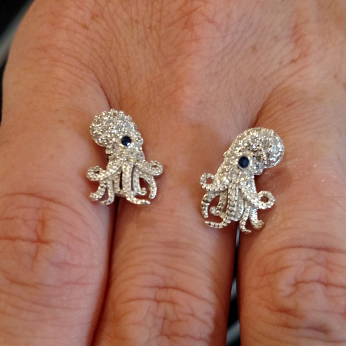 Sterling and cz octopus earrings with sapphire eyes.