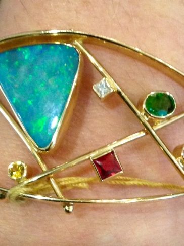 Contemporary 14k bracelet with Australian opal and gemstones.